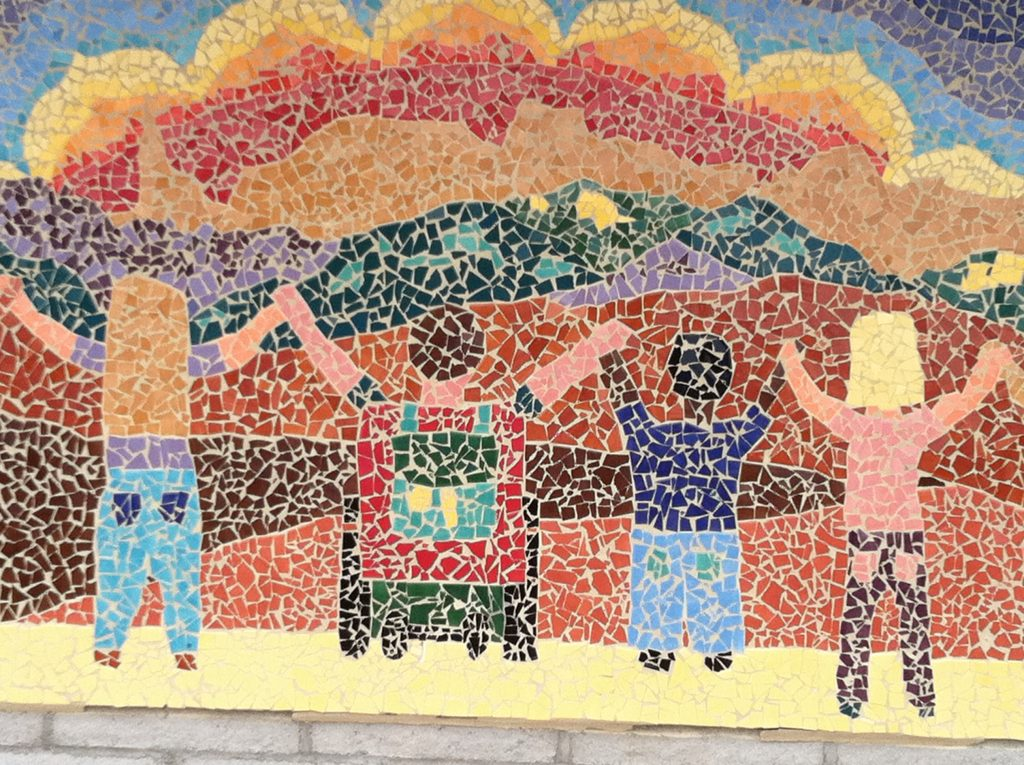 Image of tile mosaic showing children looking at the mountain